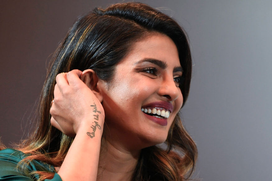 Priyanka Chopra Age, smile, tatoo on hand, instagram, wedding photos, net worth, height, husband, wiki, sister, twitter, facebook, smile, latest hot pics