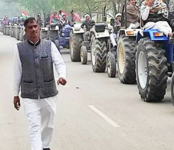 Two farmers sitting on dharna protesting against agricultural laws